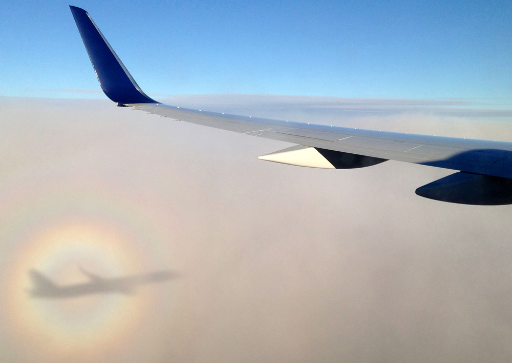 Circular Rainbow from an Airplane Window - Around the World in 18 Beds