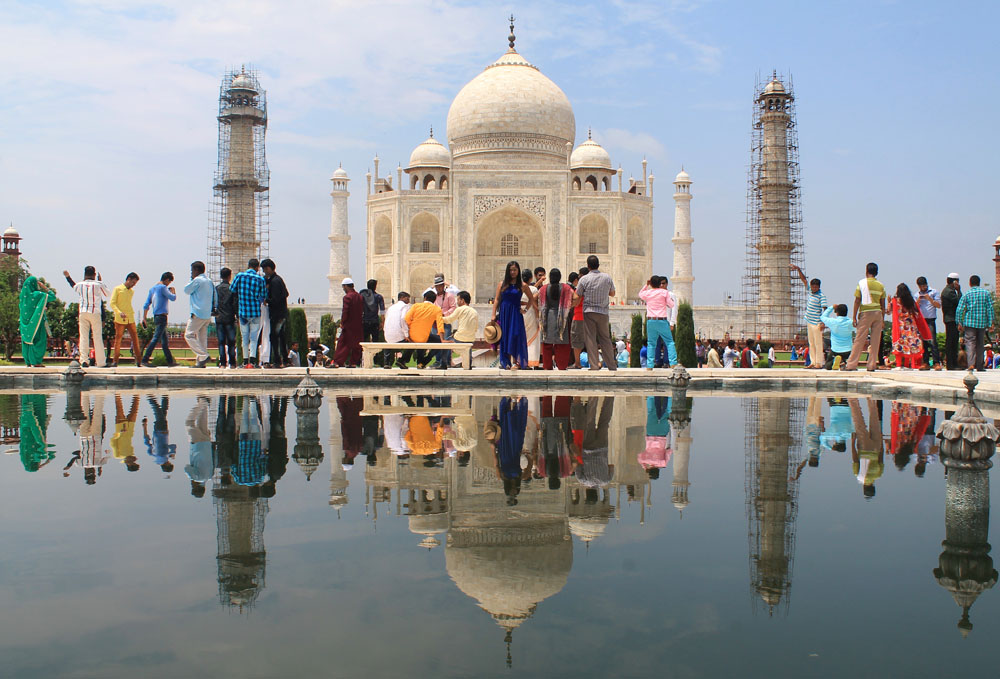 Woman wearing a blue dress in the Taj Mahal - - What to Wear in India - Fashion Tips for Female Tourists