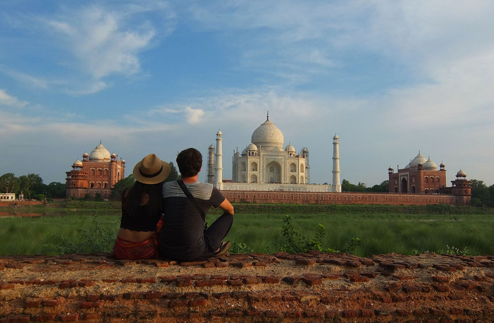 Couple enjoying the view of the Taj Mahal - Exploring the Wonder of the World, Taj Mahal